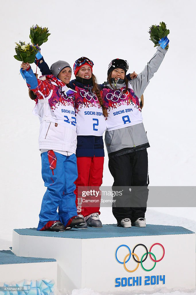 Gold medalist Maddie Bowman (C) of the United States poses with silver medalist Marie Martinod (L) of France and bronze medalist Ayana Onozuka of Japan during the flower ceremony in the Freestyle Skiing Ladies' Ski Halfpipe Finals on day thirteen of the 2014 Winter Olympics at Rosa Khutor Extreme Park on February 20, 2014 in Sochi, Russia.