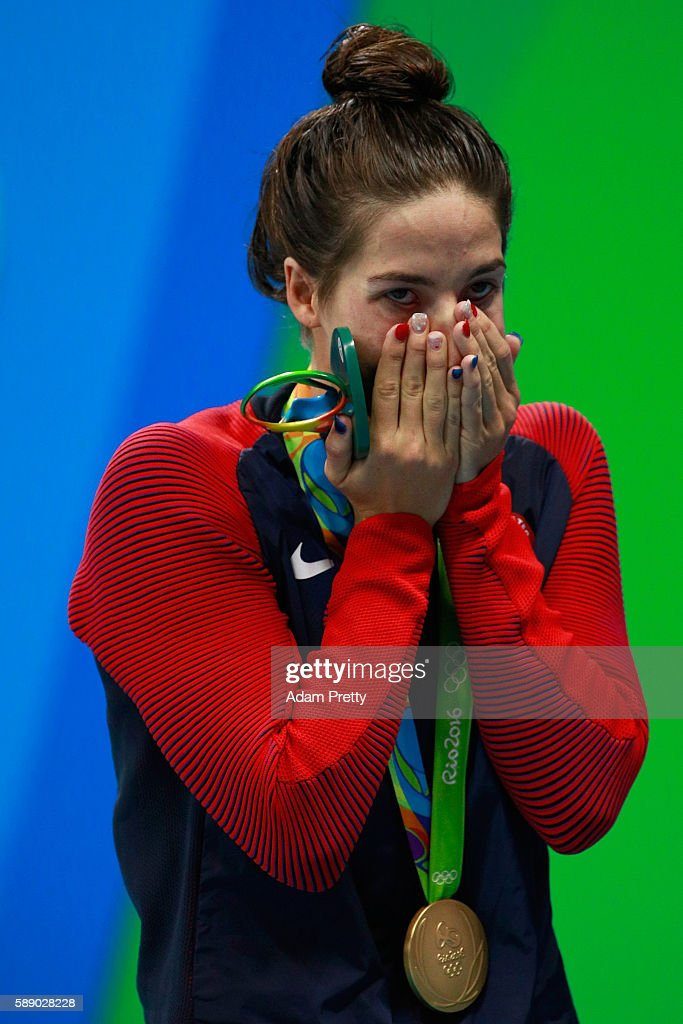 Gold medalist Madeline Dirado of the United States celebrates on the podium during the medal ceremony for the Women's 200m Backstroke Final on Day 7...