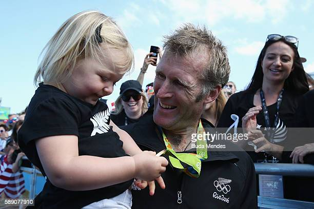 Gold medalist Mahe Drysdale of New Zealand celebrates with his daughter Bronte after the medal ceremony for the Men's Single Sculls on Day 8 of the...