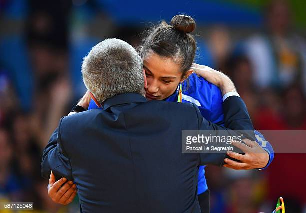 Gold medalist Majlinda Kelmendi of Kosovo is embraced by IOC President Thomas Bach during the medal ceremony for the Women's 52kg Judoon Day 2 of the...