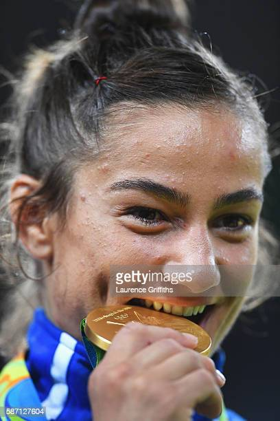 Gold medalist Majlinda Kelmendi poses during the medal ceremony for the Women's 52kg Judoon Day 2 of the Rio 2016 Olympic Games at Carioca Arena 2 on...