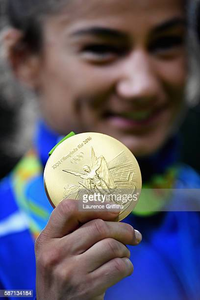 Gold medalist Majlinda Kelmendi poses during the medal ceremony for the Women's 52kg Judo on Day 2 on Day 2 of the Rio 2016 Olympic Games at Carioca...