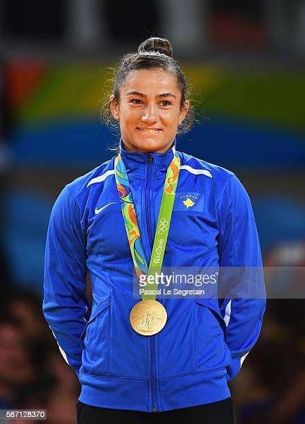 Gold medalist Majlinda Kelmendi poses on the podium during the medal ceremony for the Women's 52kg Judoon Day 2 of the Rio 2016 Olympic Games at...