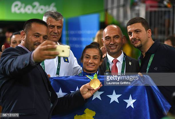 Gold medalist Majlinda Kelmendi poses with delegates after the medal ceremony for the Women's 52kg Judo on Day 2 of the Rio 2016 Olympic Games at...