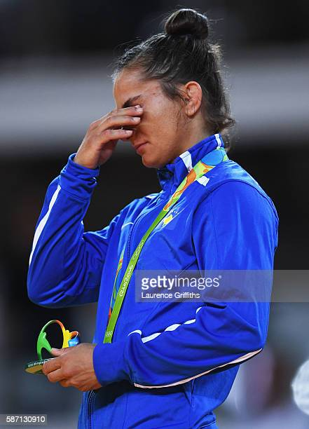 Gold medalist Majlinda Kelmendi shows her emotions during the medal ceremony for the Women's 52kg Judoon Day 2 of the Rio 2016 Olympic Games at...
