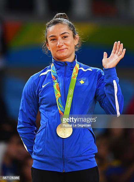 Gold medalist Majlinda Kelmendi waves on the podium during the medal ceremony for the Women's 52kg Judoon Day 2 of the Rio 2016 Olympic Games at...