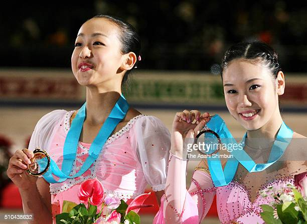 Gold medalist Mao Asada and bronze medalist Yukari Nakano of Japan celebrate on the podium at the medal ceremony for the Women's Singles during day...