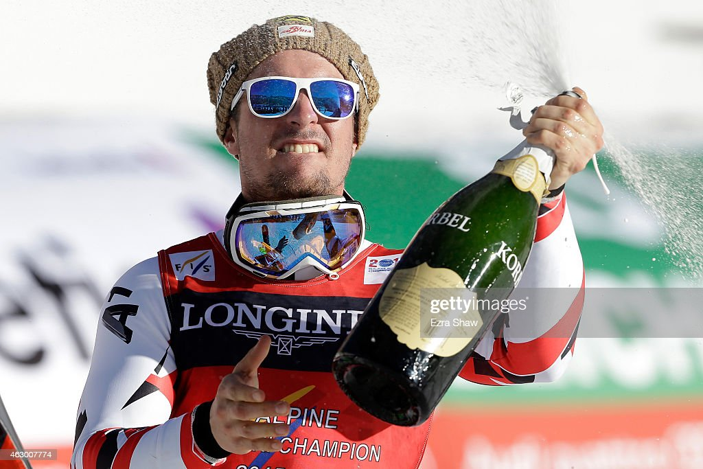 Gold medalist Marcel Hirscher of Austria celebrates with champagne after the finish of the Men's Alpine Combined Slalom run in Red Tail Stadium on...