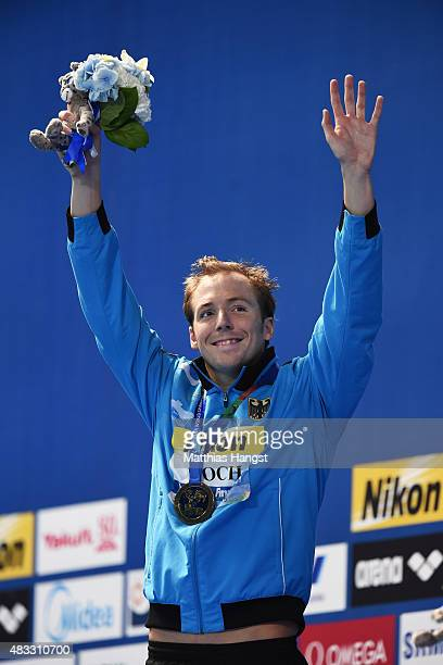 Gold medalist Marco Koch of Germany poses during the medal ceremony for the Men's 200m Breaststroke on day fourteen of the 16th FINA World...
