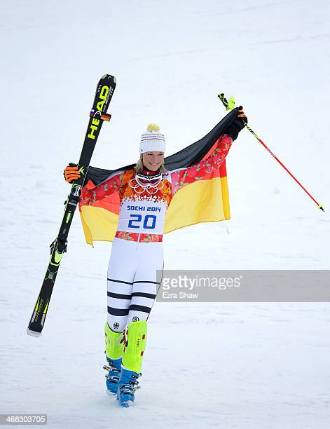 Gold medalist Maria HoeflRiesch of Germany celebrates after the flower ceremony for the Alpine Skiing Women's Super Combined on day 3 of the Sochi...