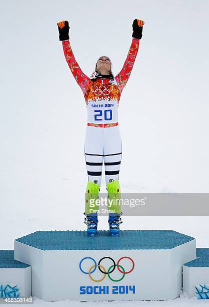 Gold medalist Maria HoeflRiesch of Germany celebrates during the flower ceremony for the Alpine Skiing Women's Super Combined on day 3 of the Sochi...