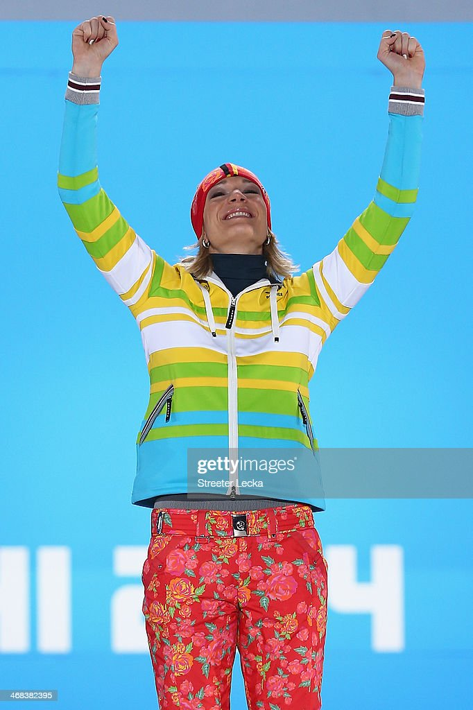 Gold medalist <a gi-track='captionPersonalityLinkClicked' href=/galleries/search?phrase=Maria+Hoefl-Riesch&family=editorial&specificpeople=7648886 ng-click='$event.stopPropagation()'>Maria Hoefl-Riesch</a> of Germany celebrates during the medal ceremony for the Alpine Skiing Women's Super Combined on day 3 of the Sochi 2014 Winter Olympics at Medals Plaza in the Olympic Park on February 10, 2014 in Sochi, Russia.