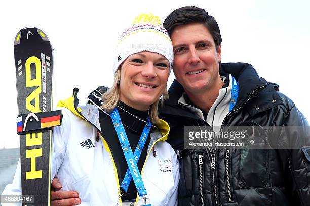 Gold medalist Maria HoeflRiesch of Germany celebrates with boyfriend Marcus Hoefl after the flower ceremony for the Alpine Skiing Women's Super...
