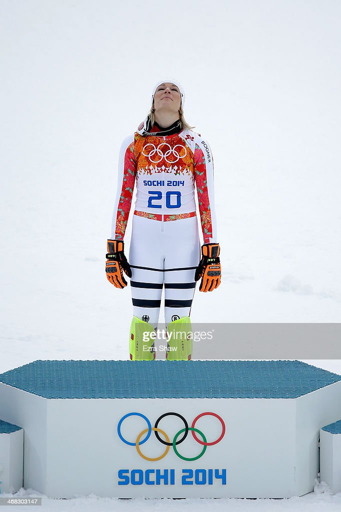 Gold medalist Maria Hoefl-Riesch of Germany reacts during the flower ceremony for the Alpine Skiing Women's Super Combined on day 3 of the Sochi 2014 Winter Olympics at Rosa Khutor Alpine Center on February 10, 2014 in Sochi, Russia.