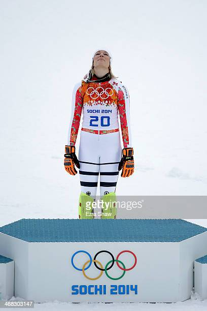 Gold medalist Maria HoeflRiesch of Germany reacts during the flower ceremony for the Alpine Skiing Women's Super Combined on day 3 of the Sochi 2014...