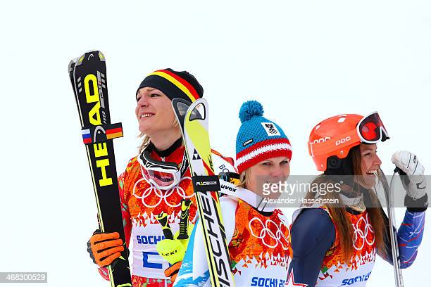 Gold medalist Maria HoeflRiesch of Germany silver medalist Nicole Hosp of Austria and bronze medalist Julia Mancuso of the United States celebrate...