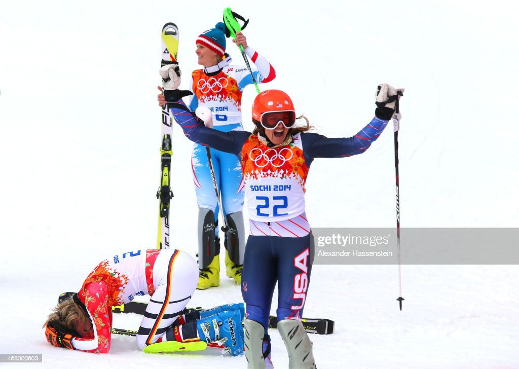 Gold medalist Maria Hoefl-Riesch of Germany, silver medalist Nicole Hosp of Austria and bronze medalist Julia Mancuso of the United States react during the Alpine Skiing Women's Super Combined Slalom on day 3 of the Sochi 2014 Winter Olympics at Rosa Khutor Alpine Center on February 10, 2014 in Sochi, Russia.