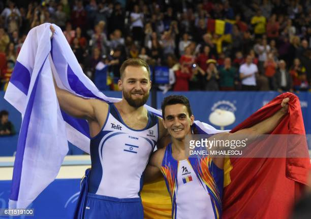 Gold medalist Marian Dragulescu of Romania and Bronze medal winner Alexander Shatilov of Israel celebrates with national flags at the end of the men...