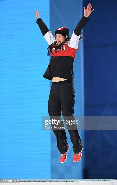 Gold medalist Marielle Thompson of Canada celebrates during the medal ceremony for the Women's Ski Cross on day fourteen of the Sochi 2014 Winter...