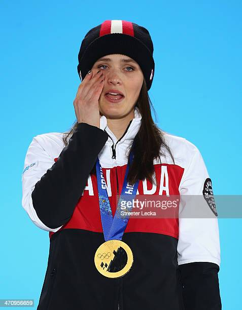 Gold medalist Marielle Thompson of Canada stands during the medal ceremony for the Women's Ski Cross on day fourteen of the Sochi 2014 Winter...