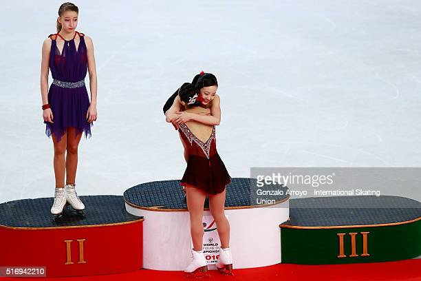 gold medalist Marin Honda hugs bronce medalist Wakaba Higuchi both from Japan as silver medalist Maria Sotskova from Russia loosk to them during the...