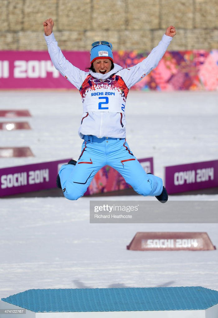 Gold medalist Marit Bjoergen of Norway celebrates during the flower ceremony for the Women's 30 km Mass Start Free during day 15 of the Sochi 2014 Winter Olympics at Laura Cross-country Ski & Biathlon Center on February 22, 2014 in Sochi, Russia.