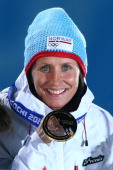 Gold medalist Marit Bjoergen of Norway celebrates during the medal ceremony for the Women's Skiathlon 75km Classic 75km Free during day 1 of the...