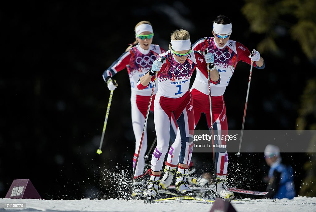 Gold medalist <a gi-track='captionPersonalityLinkClicked' href=/galleries/search?phrase=Marit+Bjoergen&family=editorial&specificpeople=216406 ng-click='$event.stopPropagation()'>Marit Bjoergen</a> of Norway (right) Silver medalist <a gi-track='captionPersonalityLinkClicked' href=/galleries/search?phrase=Therese+Johaug&family=editorial&specificpeople=4176080 ng-click='$event.stopPropagation()'>Therese Johaug</a> of Norway (front) Bronze medalist <a gi-track='captionPersonalityLinkClicked' href=/galleries/search?phrase=Kristin+Stoermer+Steira&family=editorial&specificpeople=4137577 ng-click='$event.stopPropagation()'>Kristin Stoermer Steira</a> (left) Ladies' 30 km Mass Start Free. Day 15 of the Sochi 2014 Winter Olympics at Laura Cross-country Ski & Biathlon Center on February 22, 2014 in Sochi, Russia.