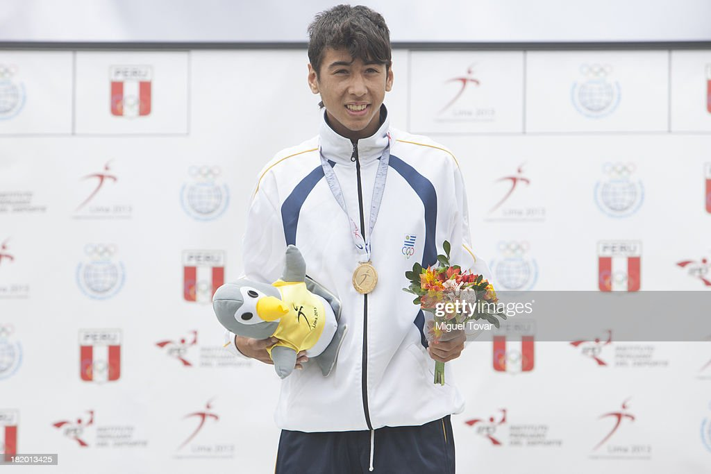 Gold medalist Martin Castañares of Uruguay in the podium of Pole Vault Men's as part of the I ODESUR South American Youth Games at Estadio Miguel Grau on September 27, 2013 in Lima, Peru.