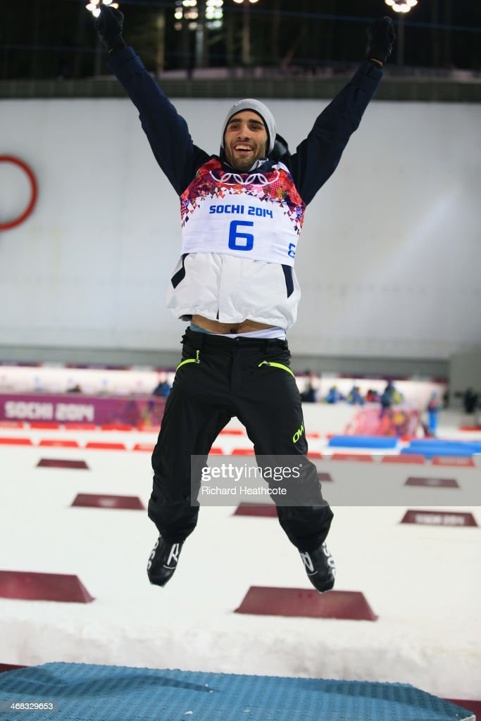 Gold medalist <a gi-track='captionPersonalityLinkClicked' href=/galleries/search?phrase=Martin+Fourcade&family=editorial&specificpeople=5656850 ng-click='$event.stopPropagation()'>Martin Fourcade</a> of France celebrates on the podium during the flower ceremony for the Men's 12.5 km Pursuit during day three of the Sochi 2014 Winter Olympics at Laura Cross-country Ski & Biathlon Center on February 10, 2014 in Sochi, Russia.