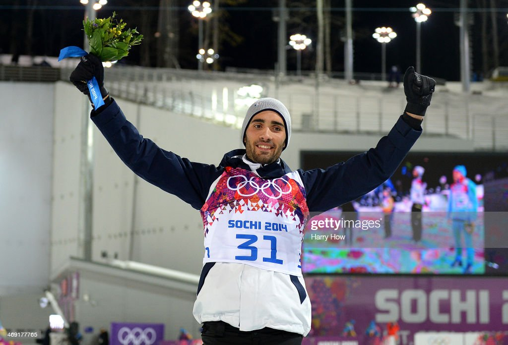 Gold medalist <a gi-track='captionPersonalityLinkClicked' href=/galleries/search?phrase=Martin+Fourcade&family=editorial&specificpeople=5656850 ng-click='$event.stopPropagation()'>Martin Fourcade</a> of France celebrates on the podium during the flower ceremony for the Men's Individual 20 km during day six of the Sochi 2014 Winter Olympics at Laura Cross-country Ski & Biathlon Center on February 13, 2014 in Sochi, Russia.