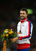 Gold medalist Martyn Rooney of Great Britain and Northern Ireland stands on the podium during the medal ceremony for the Men's 400 metres final...