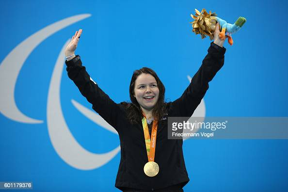 Gold medalist Mary Fisher of New Zealand celebrates on the podium at the medal ceremony for the Women's 100m Backstroke S11 Final on day 2 of the Rio...