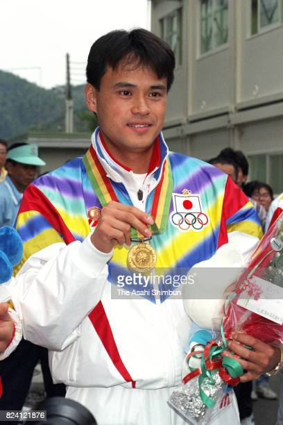 Gold medalist Masaru Nakashige of Japan celebrates after the medal ceremony for the Shooting Men's 50m Pistol during the 12th Asian Games Hiroshima...