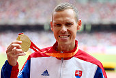 Gold medalist Matej Toth of Slovakia poses on the podium during the medal ceremony for the Men's 50km Race Walk final during day eight of the 15th...