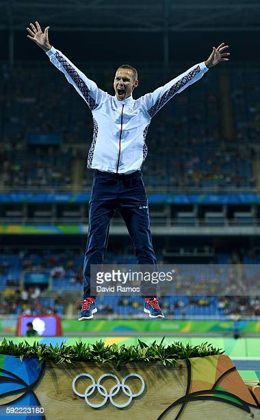 Gold medalist Matej Toth of Slovakia poses on the podium during the medal ceremony for the Men's 50km Race Walk on Day 14 of the Rio 2016 Olympic...
