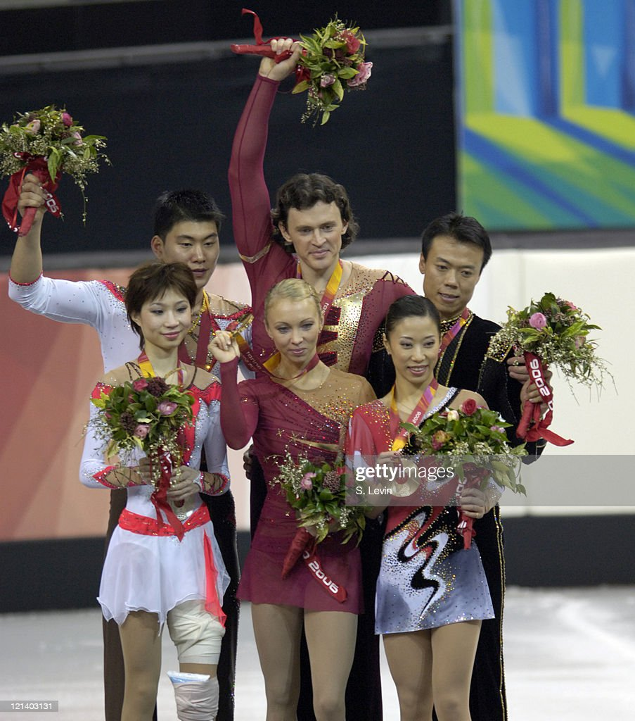 Gold medalist <a gi-track='captionPersonalityLinkClicked' href=/galleries/search?phrase=Maxim+Marinin&family=editorial&specificpeople=217462 ng-click='$event.stopPropagation()'>Maxim Marinin</a> and his partner <a gi-track='captionPersonalityLinkClicked' href=/galleries/search?phrase=Tatiana+Totmianina&family=editorial&specificpeople=211594 ng-click='$event.stopPropagation()'>Tatiana Totmianina</a> receive their gold medal along with silver medalists <a gi-track='captionPersonalityLinkClicked' href=/galleries/search?phrase=Dan+Zhang&family=editorial&specificpeople=813902 ng-click='$event.stopPropagation()'>Dan Zhang</a> and Hao Zhang, left and bronze medalists <a gi-track='captionPersonalityLinkClicked' href=/galleries/search?phrase=Hongbo+Zhao&family=editorial&specificpeople=178290 ng-click='$event.stopPropagation()'>Hongbo Zhao</a> and <a gi-track='captionPersonalityLinkClicked' href=/galleries/search?phrase=Xue+Shen&family=editorial&specificpeople=178359 ng-click='$event.stopPropagation()'>Xue Shen</a> during the medal ceremony in the Pairs Free Skate Program at the Palavela skating venue on February 13, 2006 in Torino, Italy.