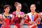 Gold medalist McKayla Maroney of the US silver medalist Oksana Chusovitina of Germany and bronze medalist Phan Thi Ha Thanh of Vietnam pose on the...