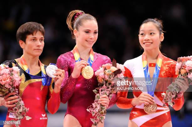 Gold medalist McKayla Maroney of the US silver medalist Oksana Chusovitina of Germany and bronze medalist Phan Thi Ha Thanh of Vietnam pose on the...