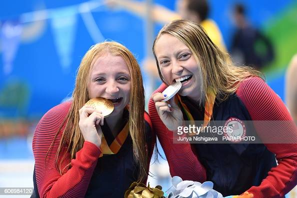 Gold medalist McKenzie Coan of United States and Silver medalist Cortney Jordan of United States celebrate on the podium at the medal ceremony for...