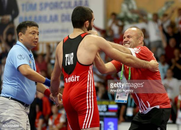 Gold medalist Mehmet Ali Yigit of Turkey celebrates after winning against Kirill Andreevich Chulkov of Russia in men's 59 kg grecoroman wrestling...