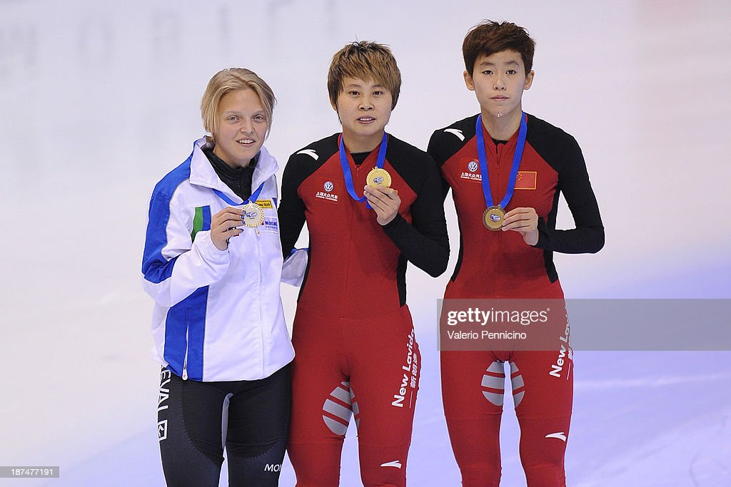 Gold medalist Meng Wang of China (C), Silver medalist <a gi-track='captionPersonalityLinkClicked' href=/galleries/search?phrase=Arianna+Fontana&family=editorial&specificpeople=4680451 ng-click='$event.stopPropagation()'>Arianna Fontana</a> (L) of Italy and bronze medalist Kexin Fan (R) of China pose during the medal presentation for the Ladie's 500m Final during day three of the Samsung ISU World Cup Short Track at the Palatazzoli on November 9, 2013 in Turin, Italy.