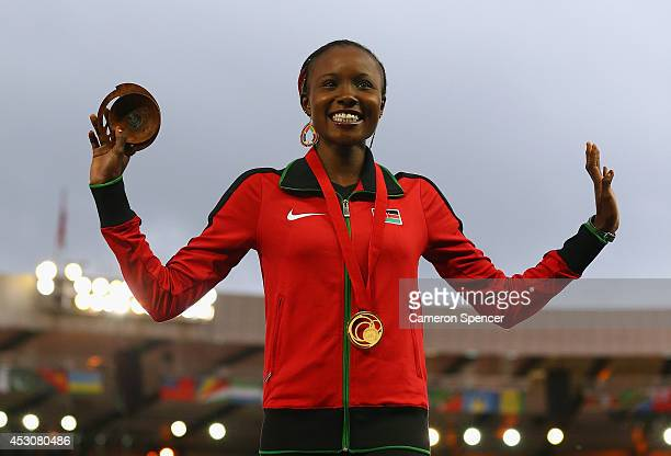 Gold medalist Mercy Cherono of Kenya poses on the podium during the medal ceremony for the Women's 5000 metres at Hampden Park during day ten of the...