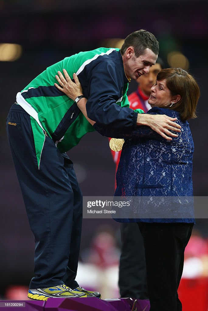Gold medalist Michael Mckillop of Ireland is presented his medal by his mum Catherine McKillop during the medal ceremony for the Men's 1500m - T37 Final on day 5 of the London 2012 Paralympic Games at Olympic Stadium on September 3, 2012 in London, England.