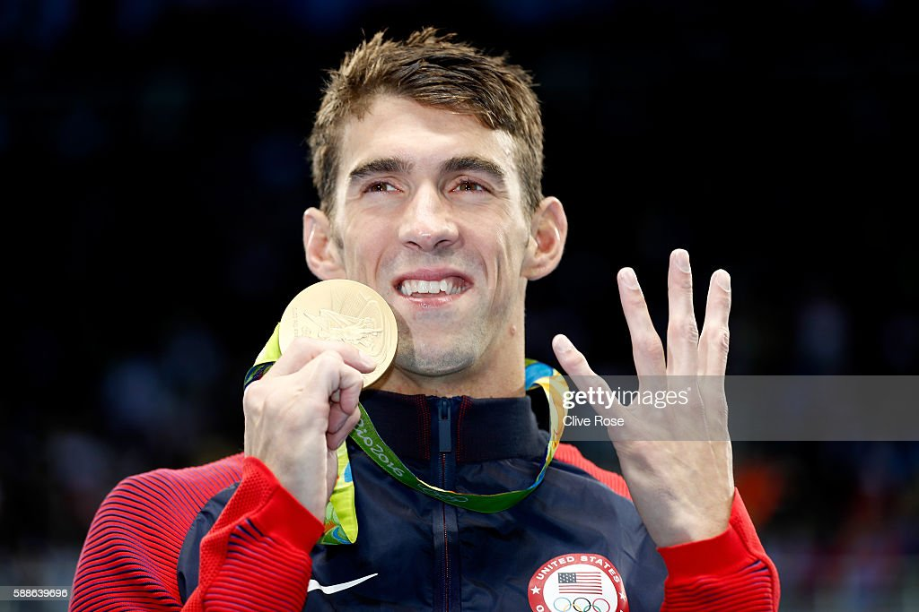 Gold medalist Michael Phelps of the United States celebrates during the medal ceremony for the Men's 200m Individual Medley Final on Day 6 of the Rio...