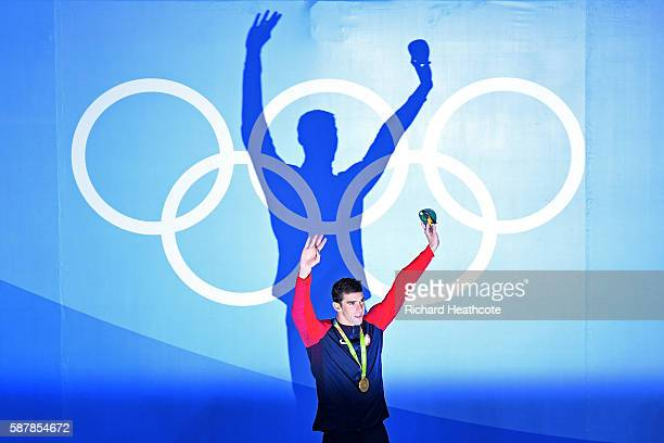 Gold medalist Michael Phelps of the United States celebrates on the podium during the medal ceremony for the Men's 200m Butterfly Final on Day 4 of...