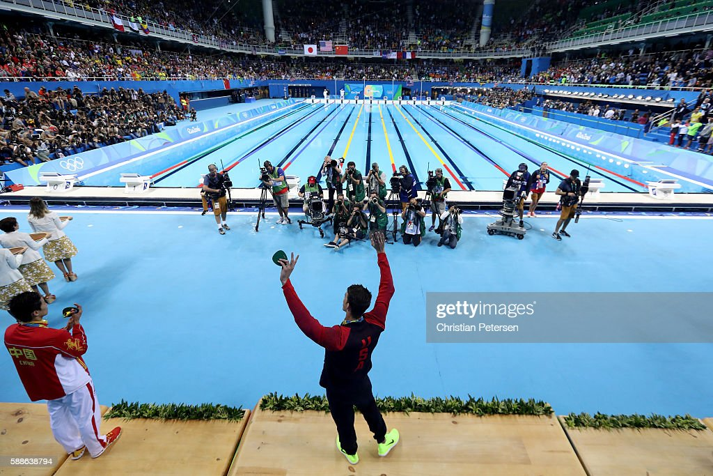 Gold medalist Michael Phelps of the United States celebrates on the podium during the medal ceremony for the Men's 200m Individual Medley Final on...