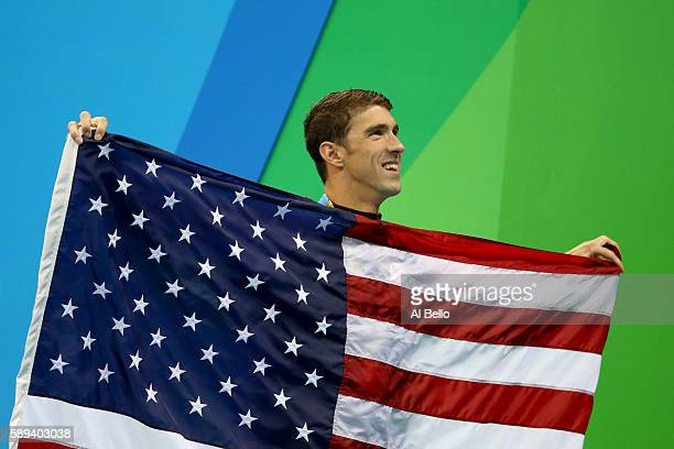 Gold medalist Michael Phelps of the United States poses during the medal ceremony for the Men's 4 x 100m Medley Relay Final on Day 8 of the Rio 2016...
