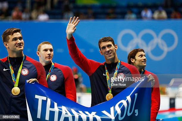 Gold medalist Michael Phelps of the United States waves to the crowd during the medal ceremony for the Men's 4 x 100m Medley Relay Final on Day 8 of...