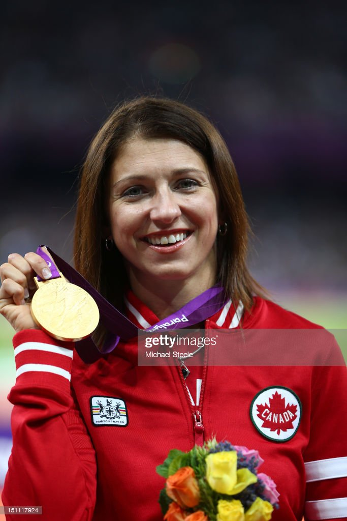 Gold medalist Michelle Stilwell of Canada poses on the podium during the medal ceremony in the Women's 200m - T52 on day 3 of the London 2012 Paralympic Games at Olympic Stadium on September 1, 2012 in London, England.
